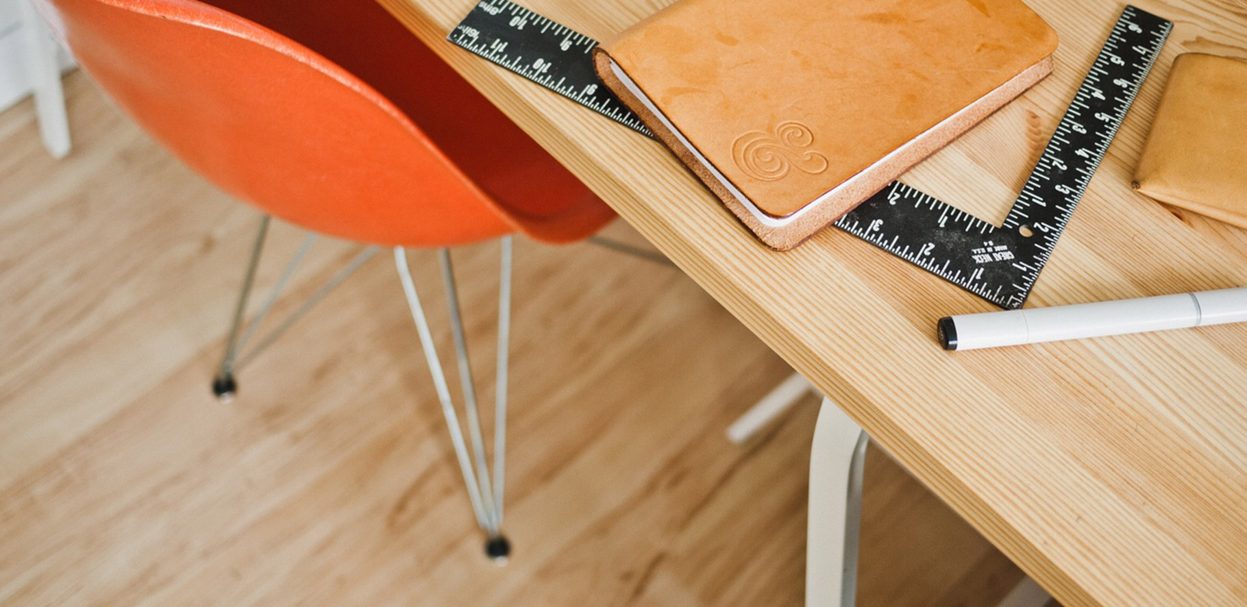 diary sitting on a table along with an empty chair