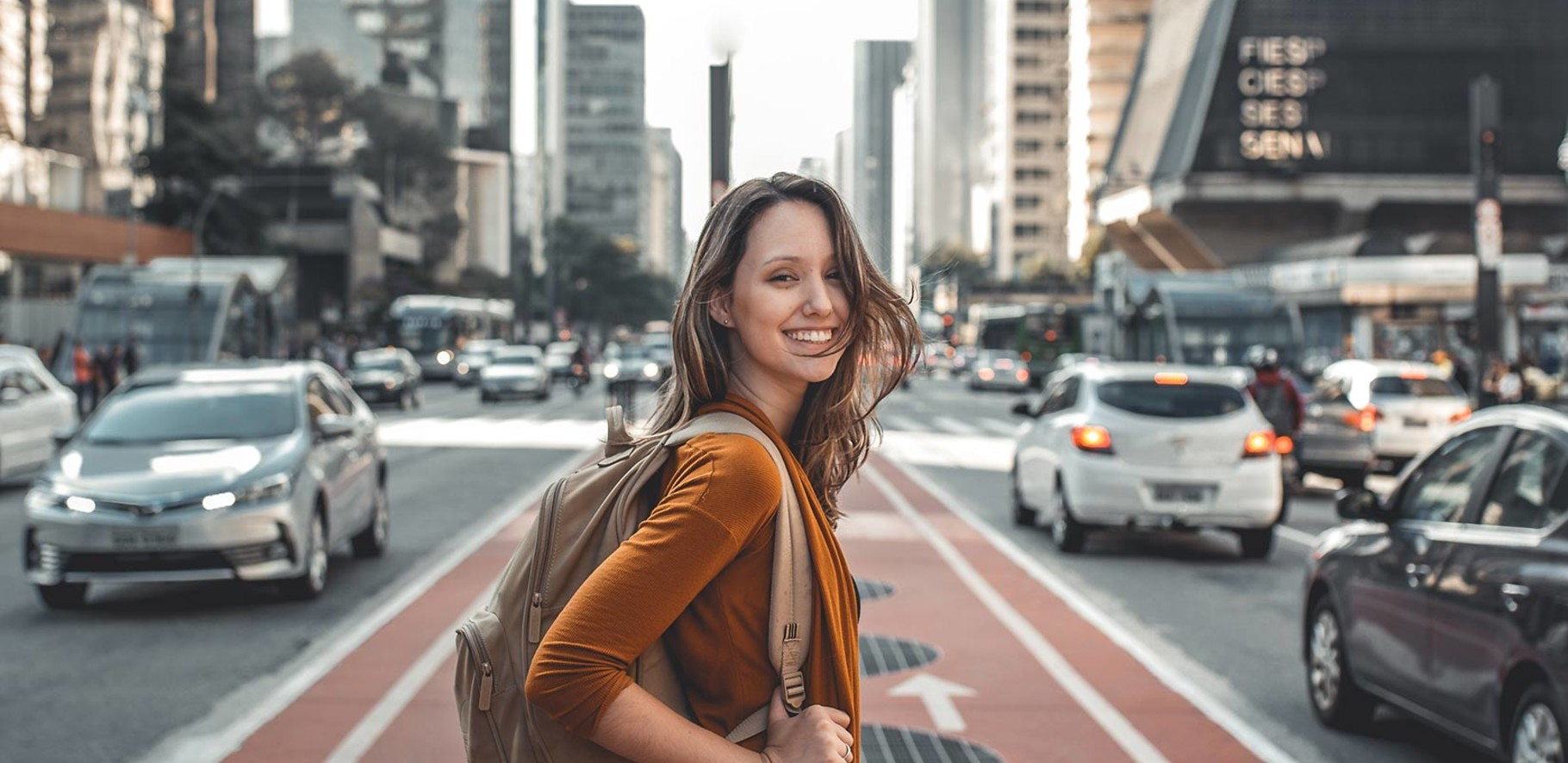 travelling girl on city street with cars