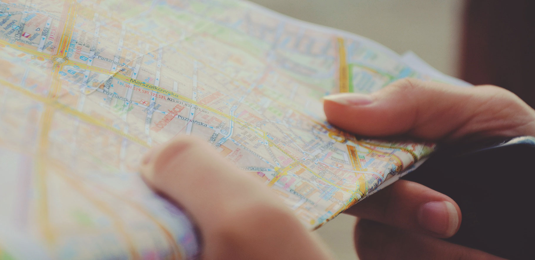 close up of a person holding a street map